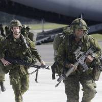 Eastern Europe has mixed reaction to NATO decision raising region's defenses against Russia