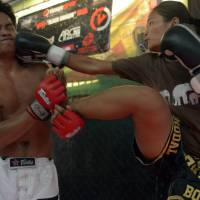 Cambodian martial artists take their ancient skills into the cage-fighting arena