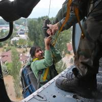Pakistani militants allege India is deliberately opening its upstream dams as a 'water bomb' creating floods