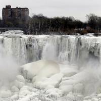 The U.S. side of Niagara Falls in New York begins to thaw after a polar vortex affected millions in the U.S. and Canada in January. | AP