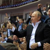 Putin calls for talks on east Ukraine 'statehood'; rebels fire on ship