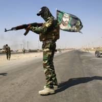 U.S., Iran deny military coordination in fight against Islamic State militants