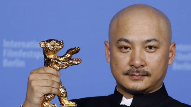 China detains famed film director for hiring prostitutes