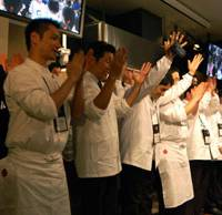 Culinary success: Japanese chefs take the stage to receive and give a round of applause at the end of this year's World of Flavors conference.