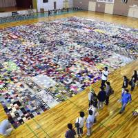 Tsunami survivors make giant blanket from knitters' donated squares