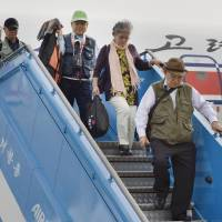 Japanese arrive in North Korea to visit graves of kin killed in war