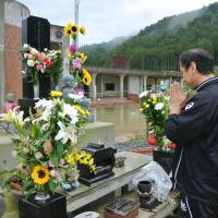 Grieving friends, family remember tsunami victims 3½ years later