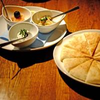 A trio of meze starters with pita bread at Kaze no Kura in Shinjuku. | ALEX DUTSON
