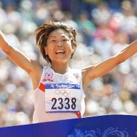 Iconic victory: Naoko Takahashi's gold medal-winning triumph in the 2000 Sydney Olympics women's marathon, was televised three times by NHK on the same day. | AP