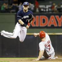 Cardinals send sinking Brewers to ninth straight defeat