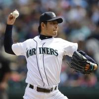 Lucky 13: Hisashi Iwakuma throws a pitch during the Mariners' win over the Nationals on Sunday in Seattle. | AP
