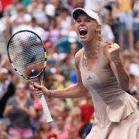 Wozniacki sends Sharapova packing