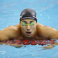 Japanese swimmer ejected from Asian Games for stealing camera