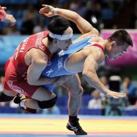 Wrestler Hasegawa earns repeat gold in 59-kg Greco-Roman division