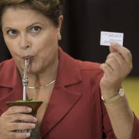 Leftist Rousseff narrowly wins second term in Brazil presidential poll