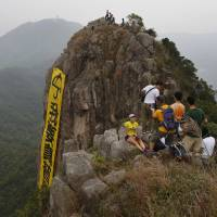 Hong Kongers hang protest banner off landmark Lion Rock cliff