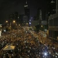 Thousands swarm outside H.K. leader's office as calls mount for his resignation