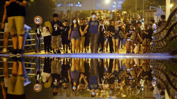 Hong Kong leaders toast national holiday as protesters jeer outside