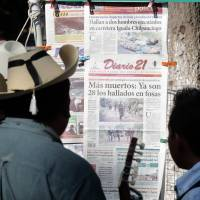 Mexico prosecutor says mass grave held 28 bodies; cops suspected in slayings