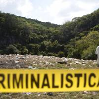 Investigators in Mexico comb gully for remains of missing students