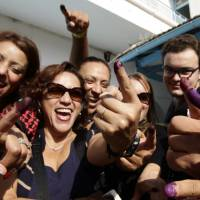 Spurred by Arab Spring, Tunisians vote in historic parliamentary election