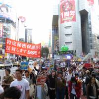 Young protesters rap state secrets law as movement gains rhythm