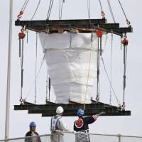 1964 Olympic caldron removed from Tokyo stadium for display in tsunami city