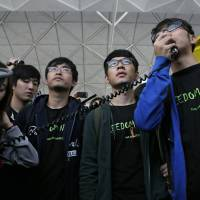 Hong Kong activists are denied permit to go to Beijing