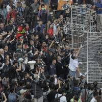 Hong Kong authorities clear some barricades from main protest camp