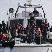 For 700 migrants, harrowing sail ends in Greece