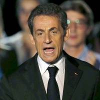 France's Sarkozy says EU powers must be halved