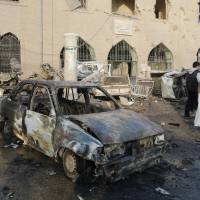 Syrian airstrikes kill more than 60 in Islamic State-held city, activists report