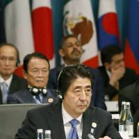 Abe's 'three arrows' backed at G-20 summit