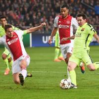 Messi brilliant again with two goals as Barca downs Ajax