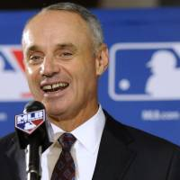 Owners give Manfred five-year term as MLB commissioner