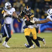 Bell runs wild as Steelers rally from 11 down to top Titans