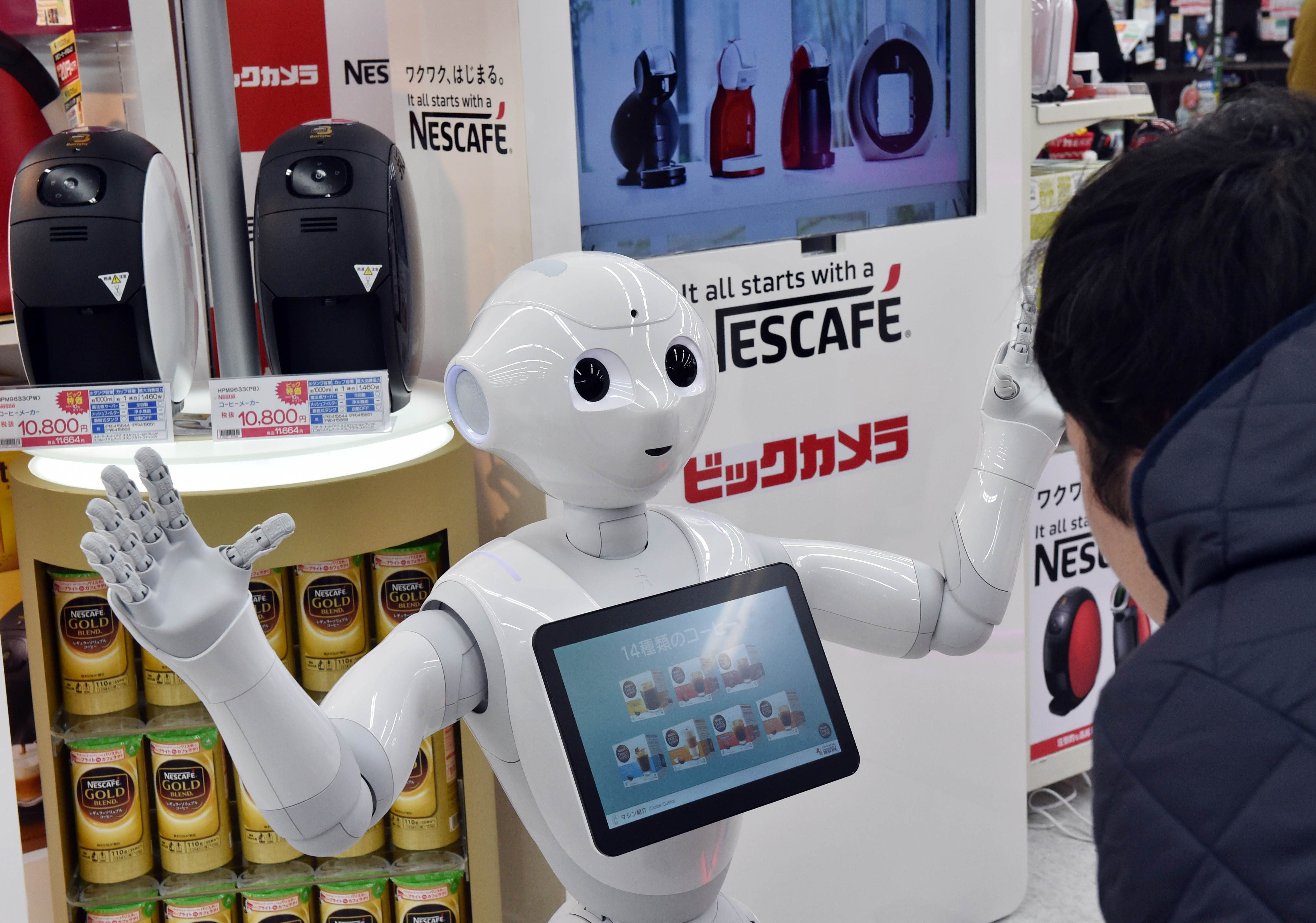 softbank 39 s pepper robot debuts as coffee machine salesman. Black Bedroom Furniture Sets. Home Design Ideas
