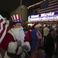 U.S. moviegoers trumpet free speech as 'Interview' opens to sell-out cinema crowds
