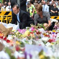 Horror over deadly Sydney siege turns to anger that 'sick' gunman slipped through the cracks