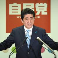 Abe claims mandate for economic, security policies despite lowest turnout ever