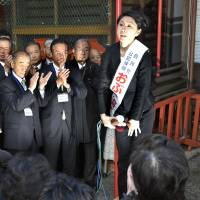 On the campaign trail, ex-minister Obuchi says sorry for scandal
