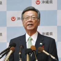 Tokyo turns up pressure on Okinawa with budget threat
