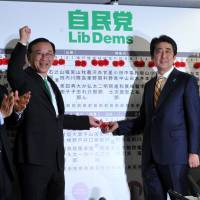 Abe tightens grip on power as ruling coalition wins 325 seats in Lower House election