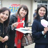 Group offers free English to kids in care in Japan and aid to children in Philippines
