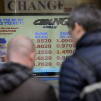 Switzerland stuns markets by giving up on currency peg