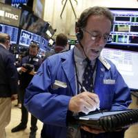Wall St. plunges 1%, weighed by commodity stocks