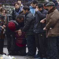 As families grieve over Shanghai crowd deaths, China manages public emotions