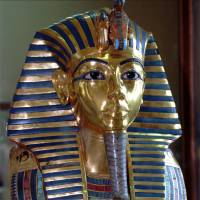 King Tut's beard knocked off during cleaning, then badly glued back on and scratched