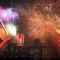 2015 begins with tragedy in Shanghai, fireworks elsewhere