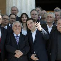 Tsipras halts privatization, throwing down gauntlet to Greece's creditors